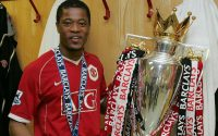Patrice Evra holds UEFA Champions League Trophy