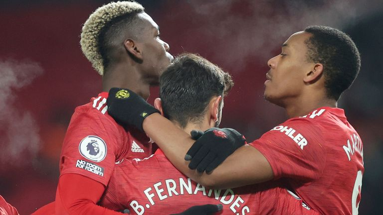 Bruno Fernandez Celebrates With Paul Pogba And Anthony Martial